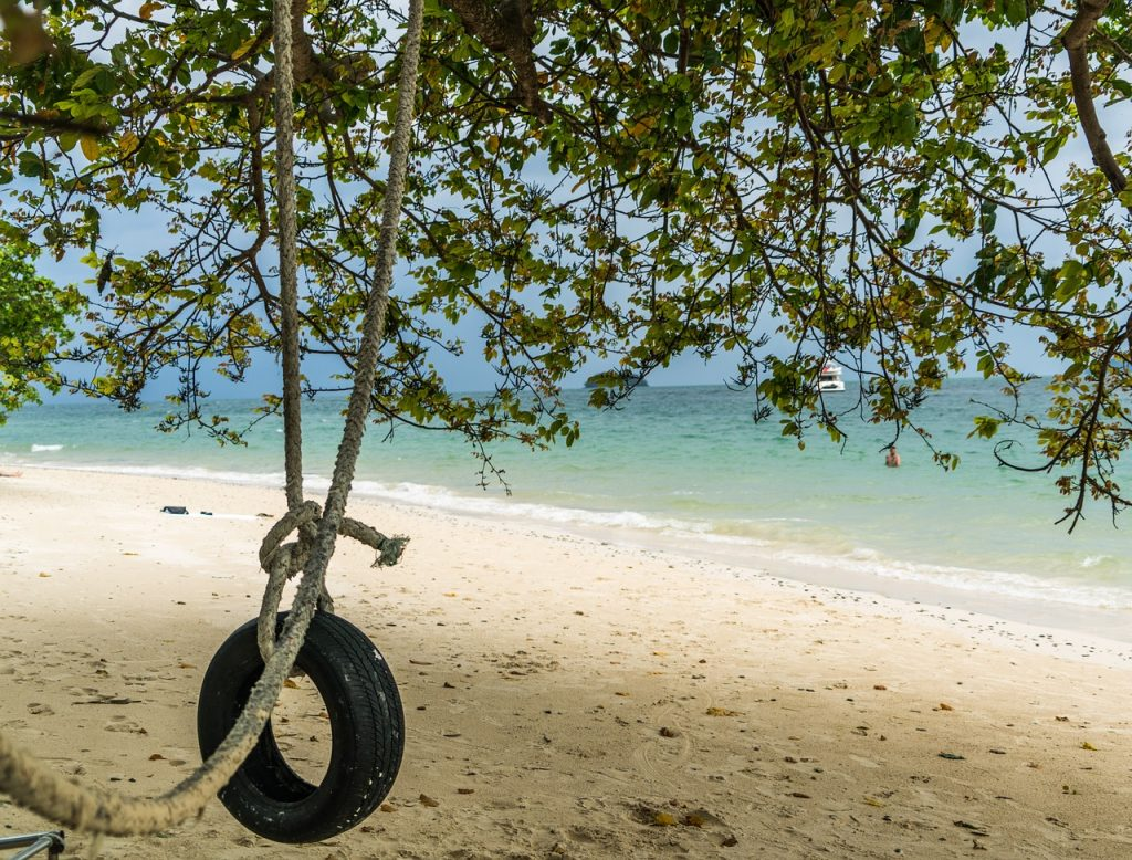 tire swing on a beach