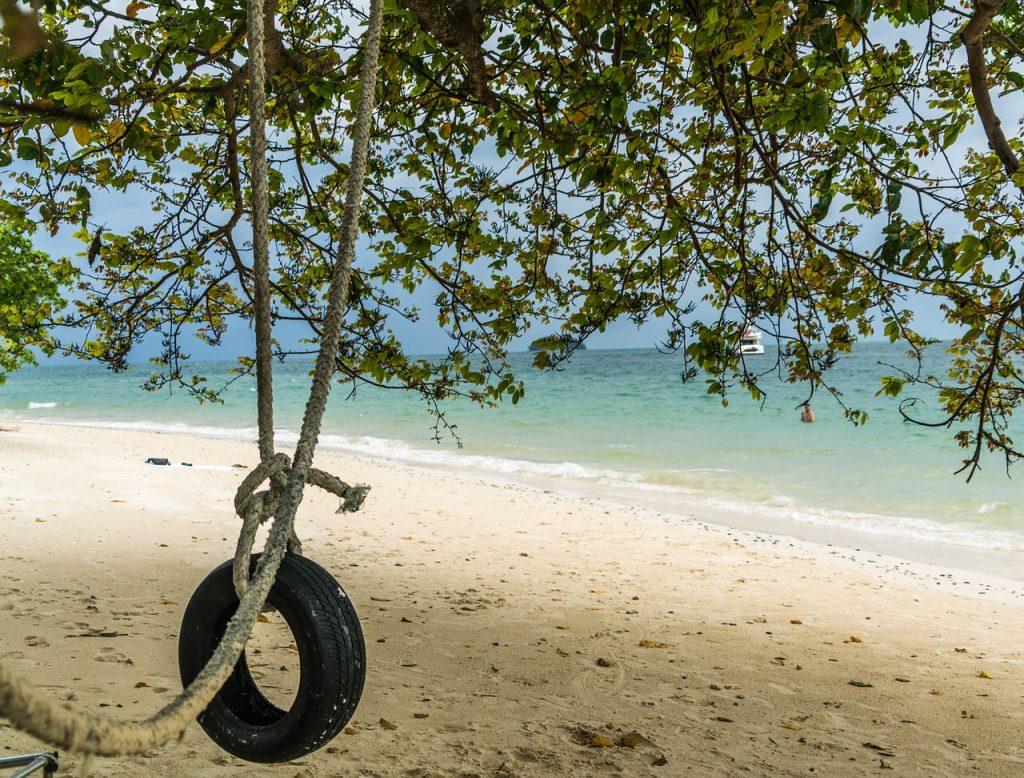 tire swing on a beach